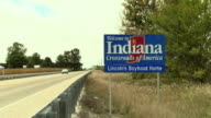 WS, Indiana state welcome sign at rural road, Butler, Indiana, USA