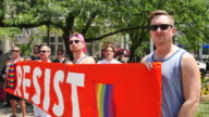 A group of men hold a banner readings 'RESIST' Members of the LGBTQ community and their allies gather to rally at Monument Circle in solidarity with...