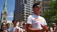 A man wears a shirt reading 'Make America Gay Again' Members of the LGBTQ community and their allies gather to rally at Monument Circle in solidarity...