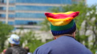 A woman wears a rainbow flag colored 'pussy hat' Members of the LGBTQ community and their allies gather to rally at Monument Circle in solidarity...