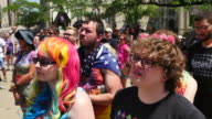 Members of the LGBTQ community and their allies gather to rally at Monument Circle in solidarity with the Equality March for Unity and Pride...
