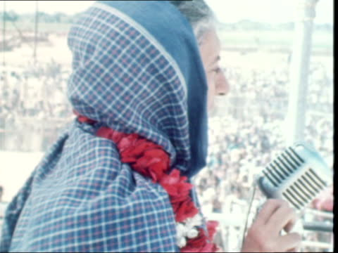 Indira Gandhi's election campaign INDIA Uttar Pradesh Raebareli EXT Mrs Indira Gandhi Prime Minister out of car Various shots Mrs Gandhi receive...