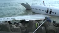 Indonesian investigators begin retrieving the wreck of a Lion Air plane that crashed at Bali airport as accounts emerged of a freak storm that could...