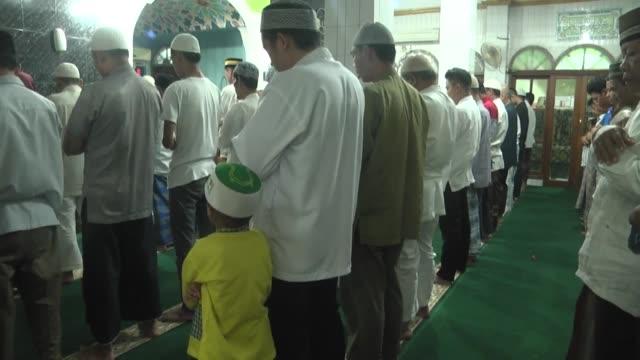 Indonesian Muslims perform the last Tarawih Prayer during the holy fasting month of Ramadan at Masjid nurul Falah in Jakarta Indonesia on June 23...