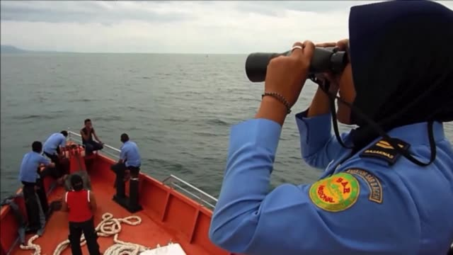 Indonesian search and rescue personnel scour the Andaman Sea for the missing Malaysian Airlines flight MH370 CLEAN Indonesia searches the Andaman Sea...