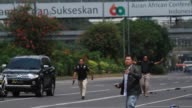 Indonesian security forces take security measures around a shopping center after a series of blasts in Jakarta Indonesia on January 14 2016...