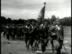 Indonesian soldiers marching flag LA CU Troops marching WS Soldiers marching w/ rifles Japan occupation Indonesia WWII