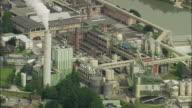 AERIAL Industrial area in town by river between hills, Hallein, Salzburg, Austria