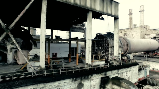 Industrial area. Part of functioning rotary kiln