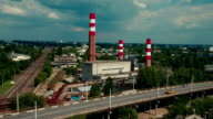 Industrial area with factory red chimneys. Aerial shooting