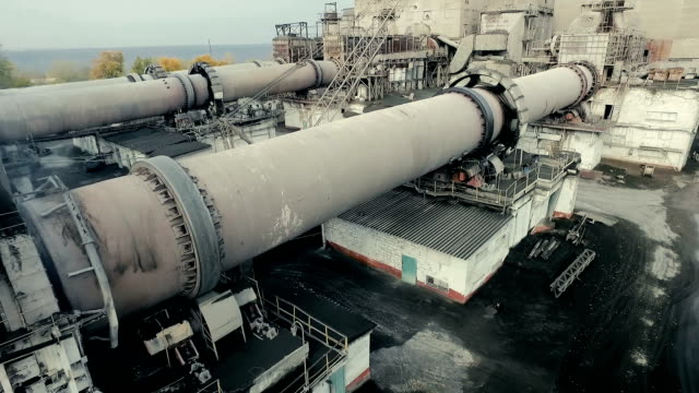 Industrial area with functioning rotary kiln. Aerial shooting