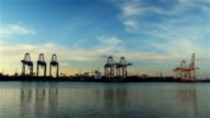 Industrial port and with working crane bridge in shipyard.