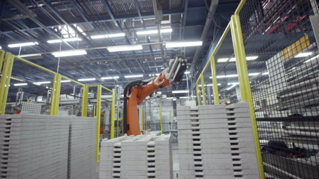 CS Industrial robot in operation at a factory