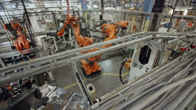 CS Industrial robots in operation in the factory