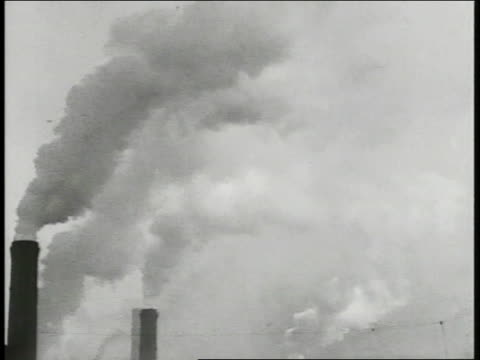 Industrial warehouse buildings many smoke stacks smoking TU WS Smoke filled sky INT Steel Mill w/ furnace fire steel moving out of furnace INT...