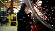 Industrial worker grinding