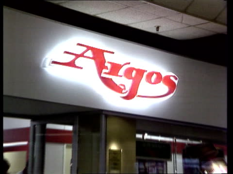 BAT Industries takeover bid ITN LIB London AV 'Argos' shop sign PULL OUT shop front in arcade TCMS Pages of Argos catalogue