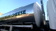 Joseph Heler Cheese Factory EXT Joseph Heler lorry in factory yard Dairy cows in large cow shed/ cows attached to mechanical milking machines