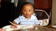 MS Infant boy sitting in highchair during breakfast