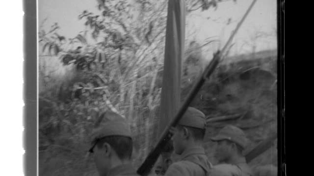 Infantrymen of the Imperial Japanese Army transport cannons and mountain guns as they follow a path along the Irrawaddy Gorge they use a pack...