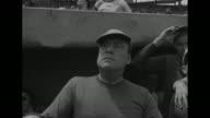 VS infield of Wrigley Field / CU Eddie Bracken / MS Sonny Tufts signs autographs / CU batgirl Marilyn Monroe / CU Alan Mowbray / WS fans applaud in...