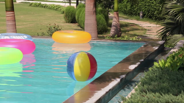 Inflatable rings and ball floating in the swimming pool, Delhi, India