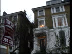 Inflation falls ITN London LA GV House with `For Sale' sign outside MS `For Sale' sign outside house