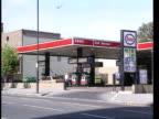 Inflation falls ITN GV Esso petrol station