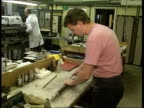Inflation rate falls SEQ Engineering factory workshop as men working