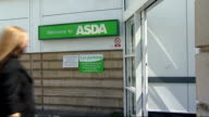 price data collectors supermarket GVs EXT People entering and leaving Asda supermarket/ female price chekcer into Asda supermarket and leaving Asda...