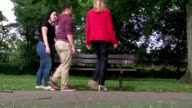 EXT Various of Anthony Johnson his partner Joanna Ahmed pushing their children on swings at playground Reporter along to bench with Johnson and Ahmed...