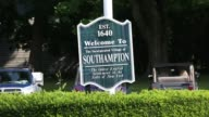 Information and welcome signs are seen in Southampton NY on July 23 2017 Photographer Timothy Fadek Shots CU of American flag blowing in the wind...