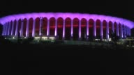 Inglewood Calif Broll of The Forum arena lit up in purple for Prince Wide medium and closeup footage of the building