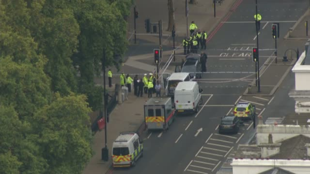 11 injured after car hits pedestrians near Natural History Museum ENGLAND London South Kensington of police vehicles and officers at scene of car...