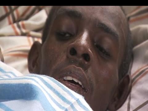 Injured people await further medical treatment following following devastating earthquake Haiti 17 January 2010