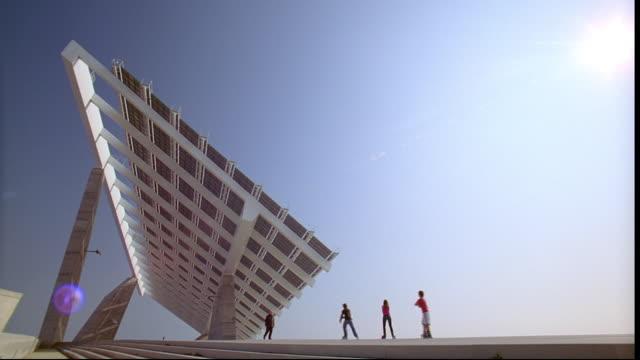 Inline skaters enjoy the concrete expanse in Barcelona's Forum Esplanade.