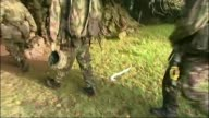 Inquest into deaths of three men during SAS training march on Brecon Beacons DATE LIB Various shots of soldiers along in wooded area during training