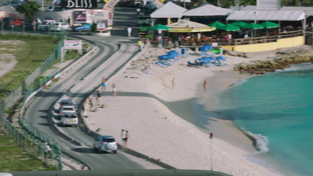 WS TS Insel Air plane flying over beach and landing on runway in airport / St. Maarten