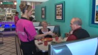 WGN Inside Circa '57 Diner Waitress At Table In 1950s Diner on October 23 2013 in Arlington Heights Illinois