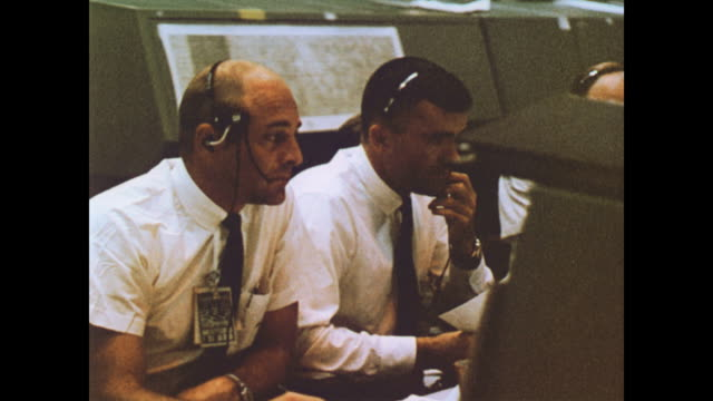 Inside the NASA control room / Apollo 11 lunar module flying past the moon as audio from mission control is heard / Neil Armstrong says the famous...