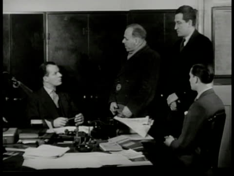 'Inspector Finch' and 'Lt Roberts' at desk listening to cab driver witness 'Well that's all governor' 'Finch'' standing up 'thank you I think that's...