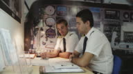WS instructor explaining aviation charts to student, RED R3D 4k