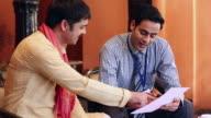 Insurance advisor dealing with a farmer, Delhi, India