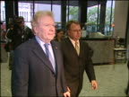"""Insurance mogul Michael """"Mickey"""" Segal leaves courtroom after jury conviction of 26 counts of racketeering fraud embezzlement in June 2004"""