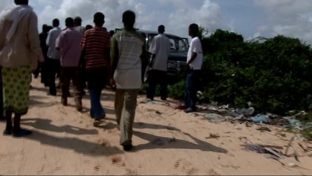 Insurgency brings bloodshed and chaos to Mogadishu Crowd gathers round body of Ali Shamarke Body of Ali Shamarke lying by car