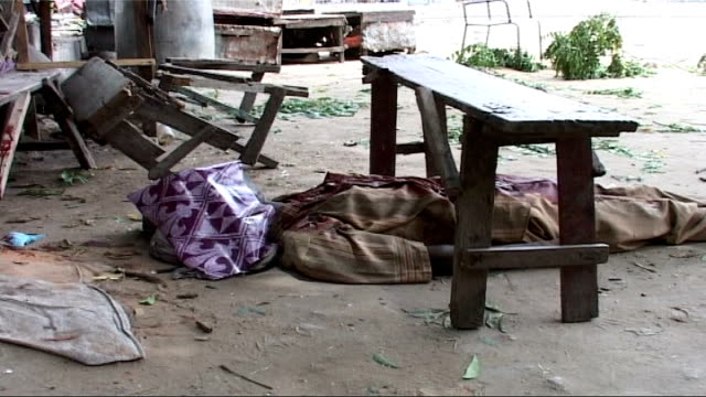Insurgency brings bloodshed and chaos to Mogadishu Dead body with face covered lying under table Body under tree as man along on cart pulled by...