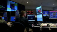 Integrated Command Center / PAN command center control room technicians at their work stations and computer monitors NORAD Command Center on December...