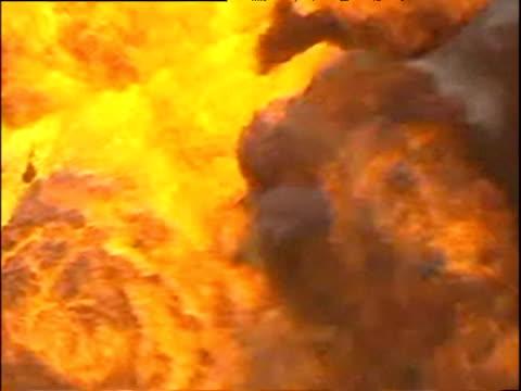 Intense orange fire and black smoke billowing from oil well fire Kuwait