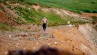 Intense running on the rocky mountain