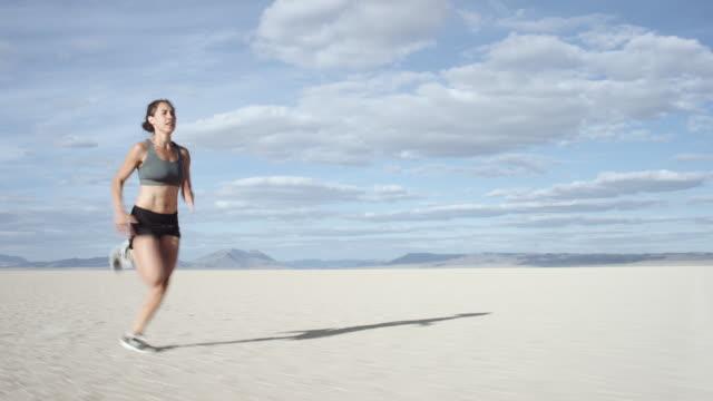 Intense Woman Running through Desert